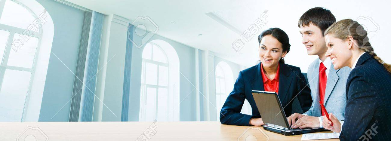 Photo of three office workers sitting at the table on the background of office building Stock Photo - 2885481