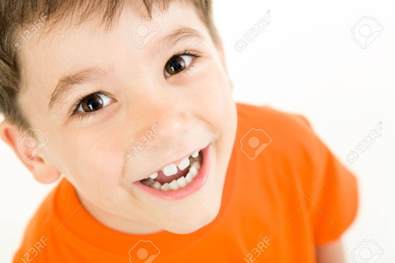 Portrait of happy boy laughing on a white background Stock Photo - 3103288