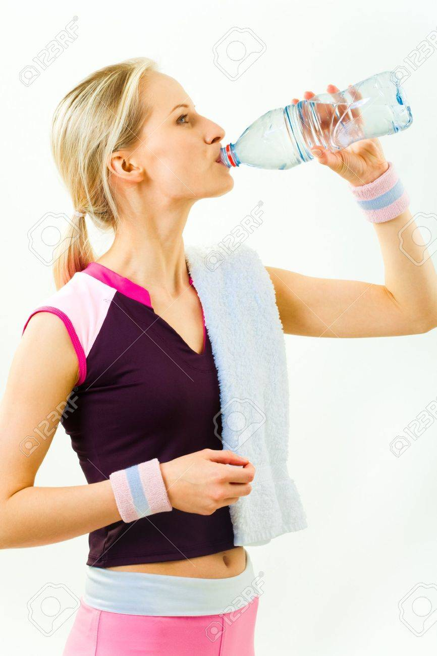 Photo of girl standing in profile and drinking water after workout on white background Stock Photo - 3115693