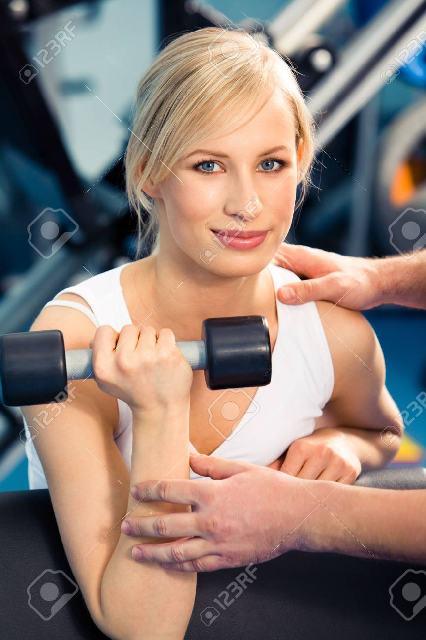 Photo of strong woman lifting dumbbell and looking at camera Stock Photo - 3115704