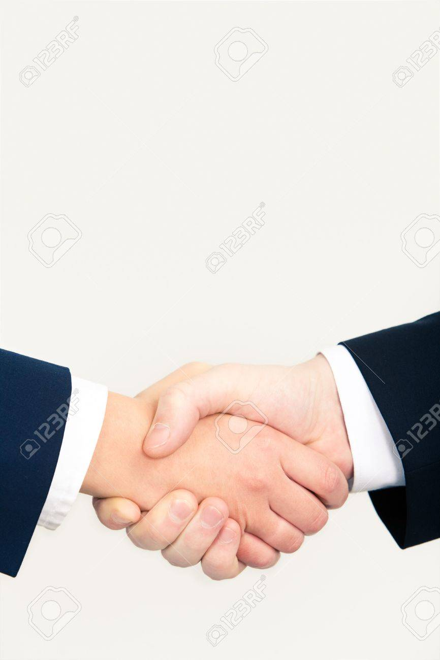 Vertical image of people�s handshake after striking successful business deal Stock Photo - 3143250