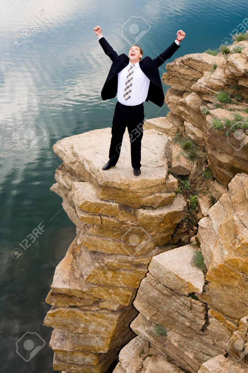 Portrait of happy businessman screaming and standing on the mountain Stock Photo - 3196528