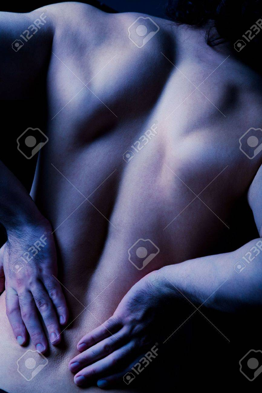Rear view of diseased male back in a dark blue color Stock Photo - 3210332
