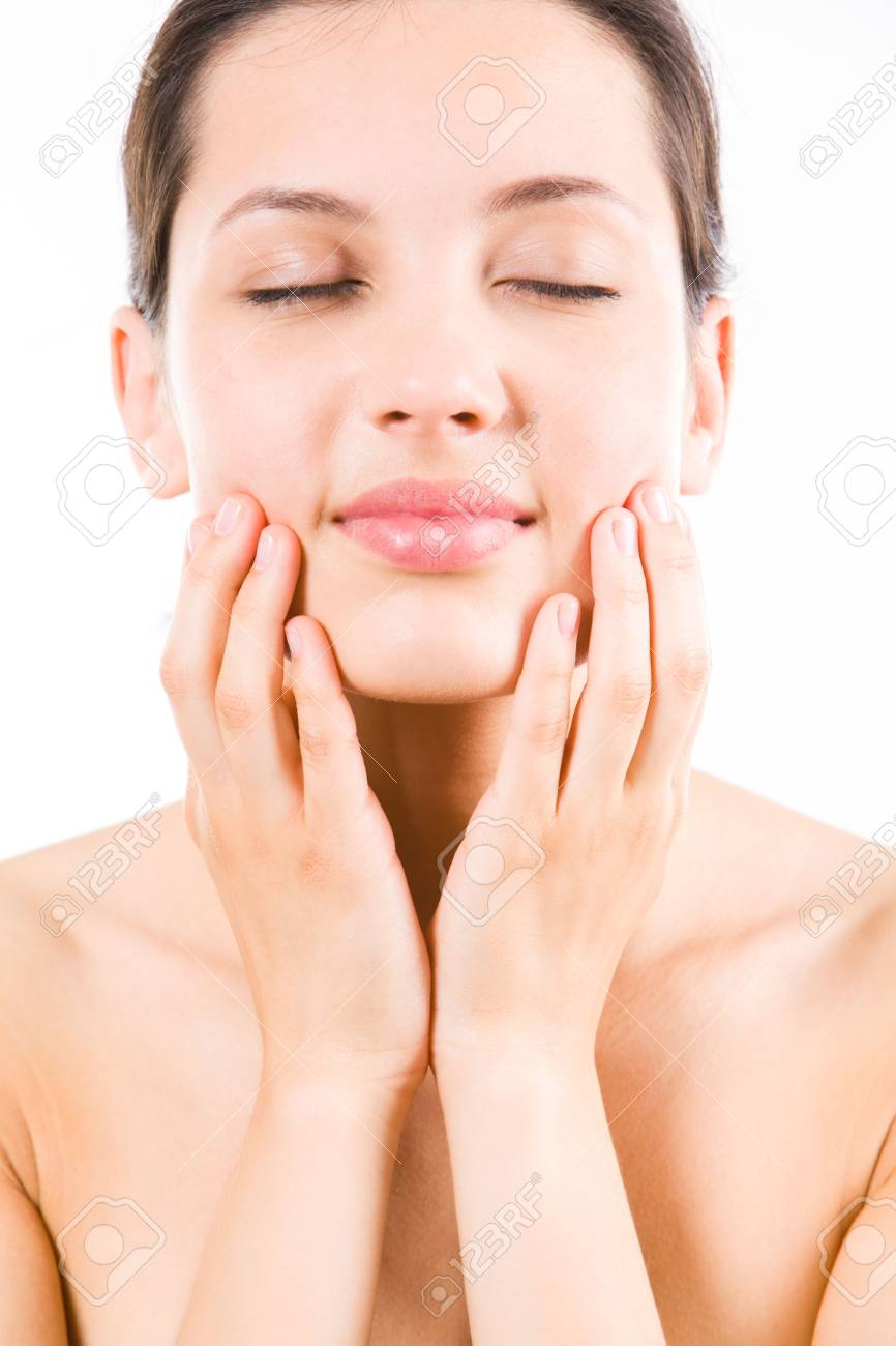 Close-up of pretty young woman touching her face Stock Photo - 3210291
