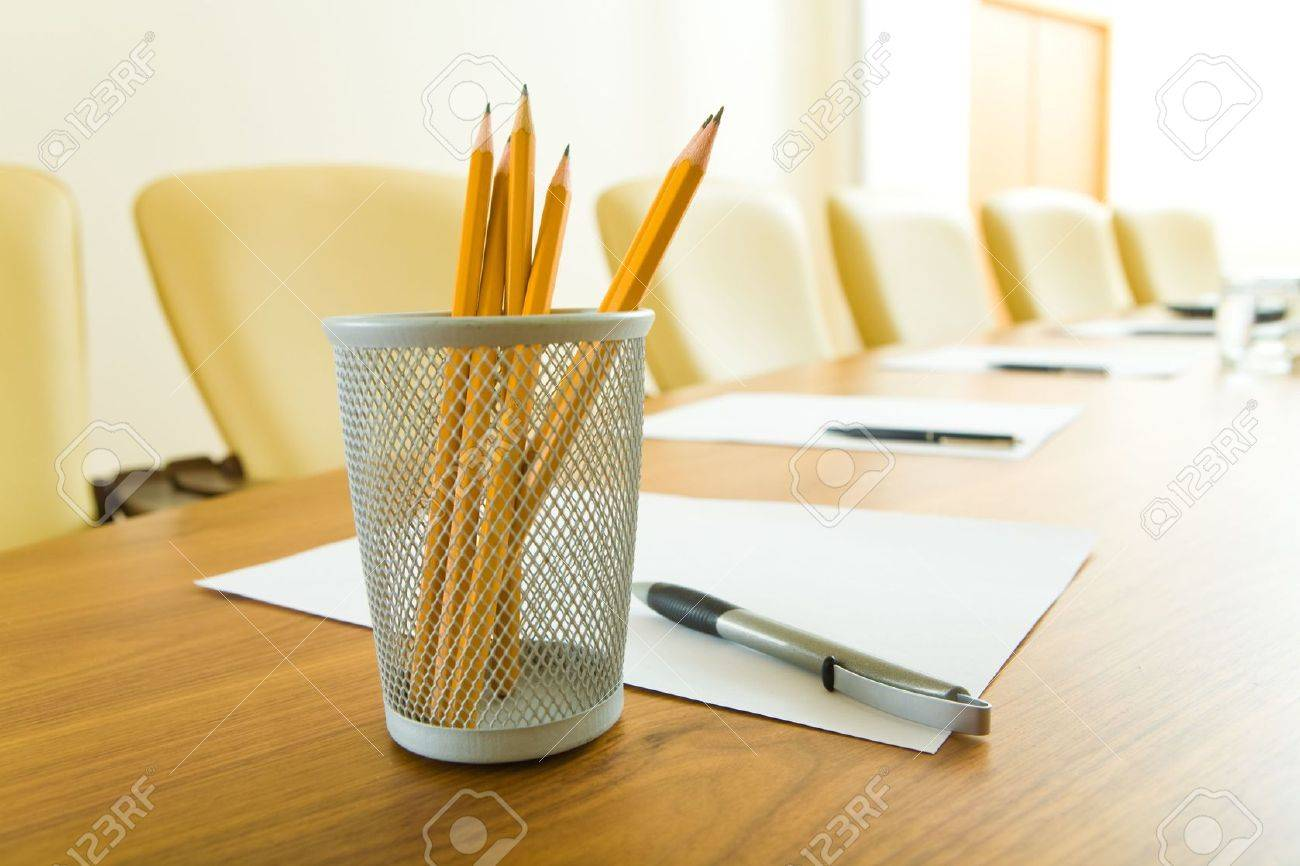 Photo of pencils in plastic glass, some pens and papers on the table in office Stock Photo - 3246186