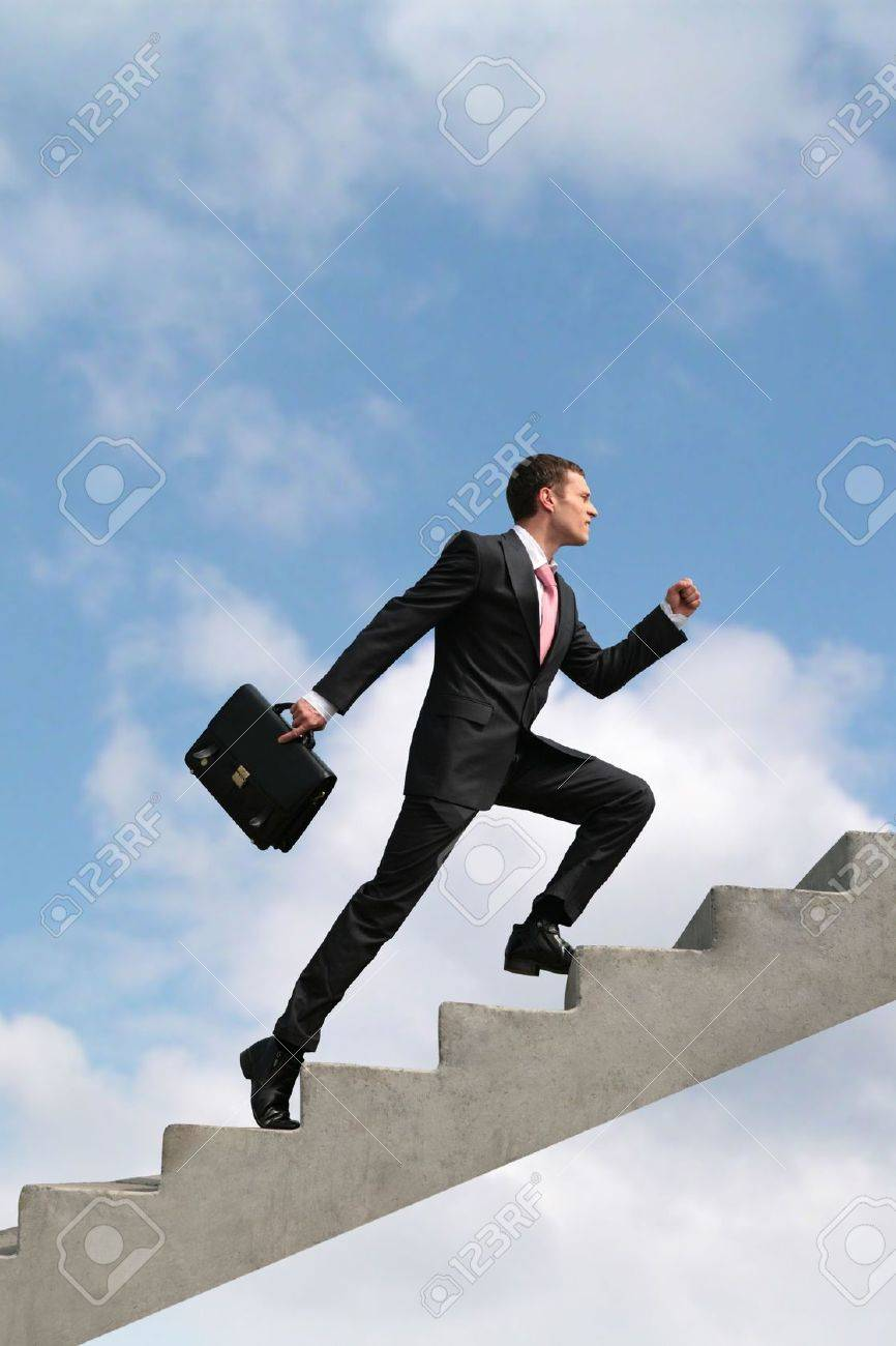 Image of confident businessman with briefcase walking upstairs Stock Photo - 3292124