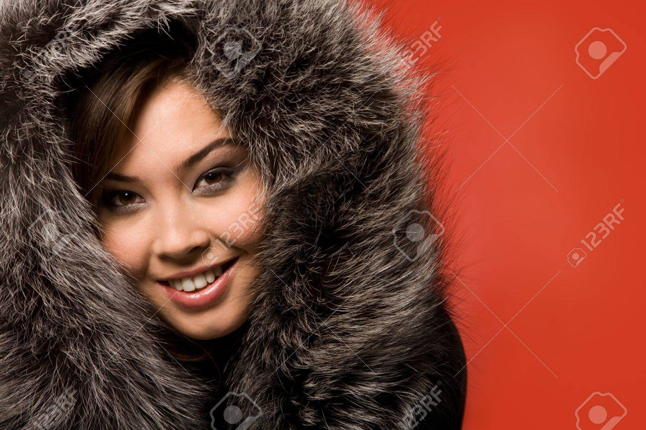 Face of beautiful girl in fur-cap looking at camera with smile Stock Photo - 3725083