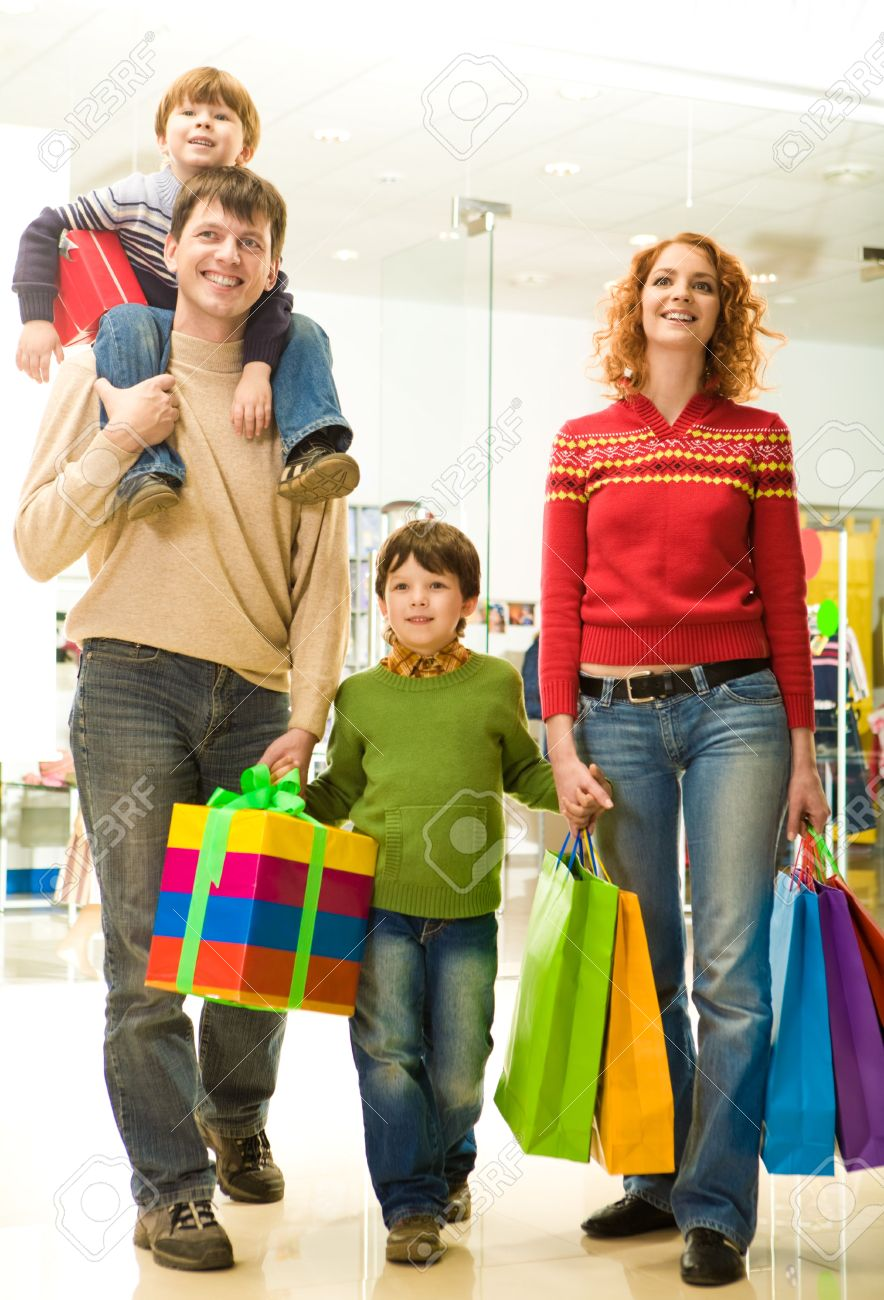 Modern family going shopping in trade center before Christmas time Stock Photo - 3883184