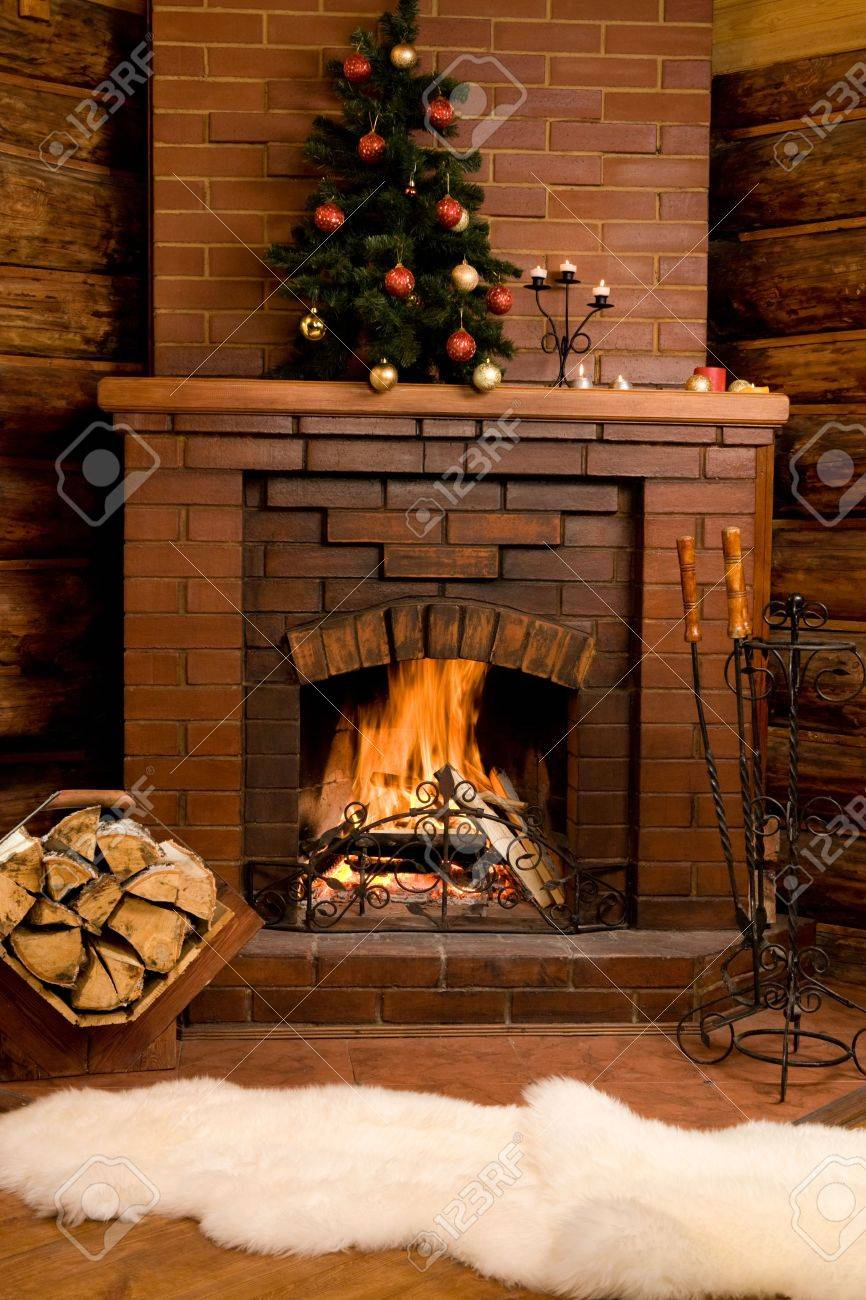 Photo of fireplace with firewood and warm white fur near by Stock Photo - 3889509