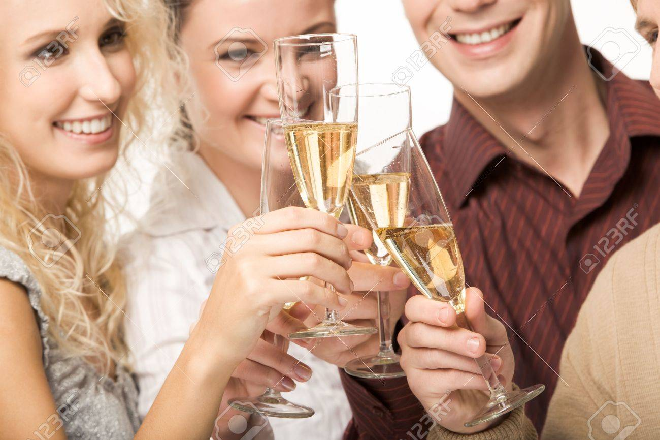 Photo of happy friends holding glasses full of champagne and smiling during party Stock Photo - 3929233