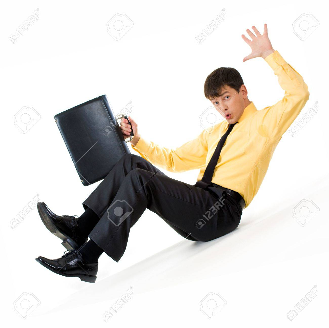 Photo of confused man sliding down during financial crisis Stock Photo - 3929159