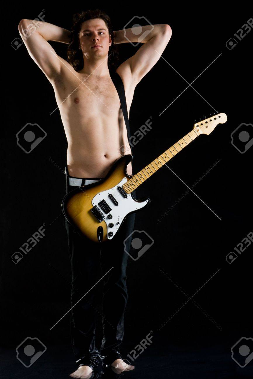 Portrait of young performer with bare torso and guitar standing in water Stock Photo - 4704708