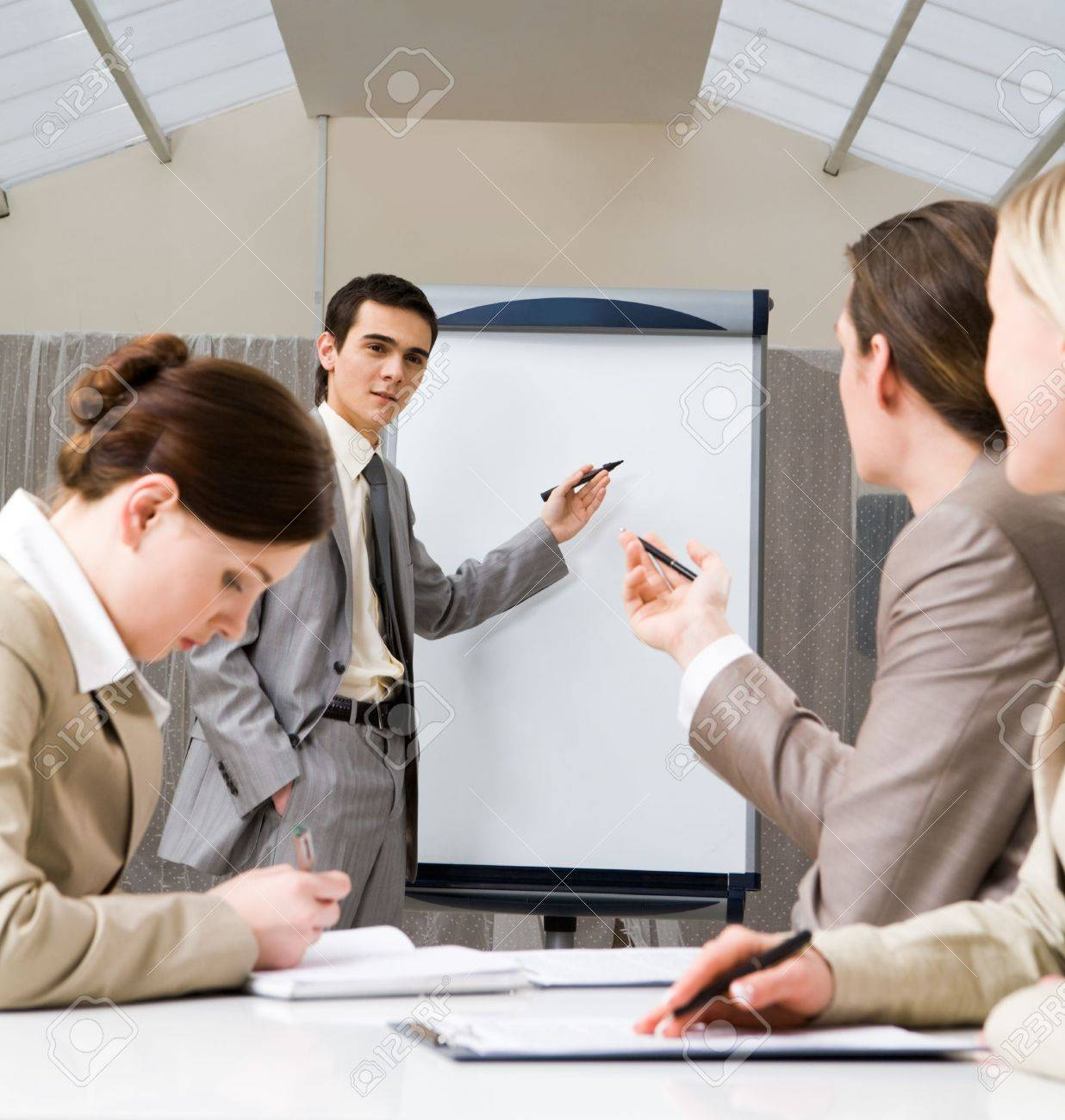 Photo of successful businessman sharing ideas by whiteboard and communicating with partners at presentation Stock Photo - 4920753