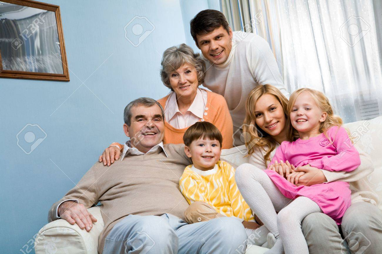 Portrait of senior and young couples with two children looking at camera at home Stock Photo - 6091821