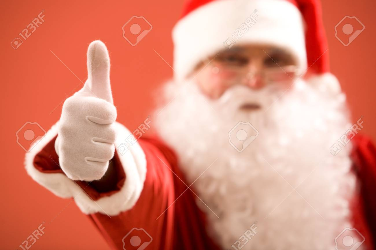 Photo of thumb up shown by Santa Claus Stock Photo - 6106943