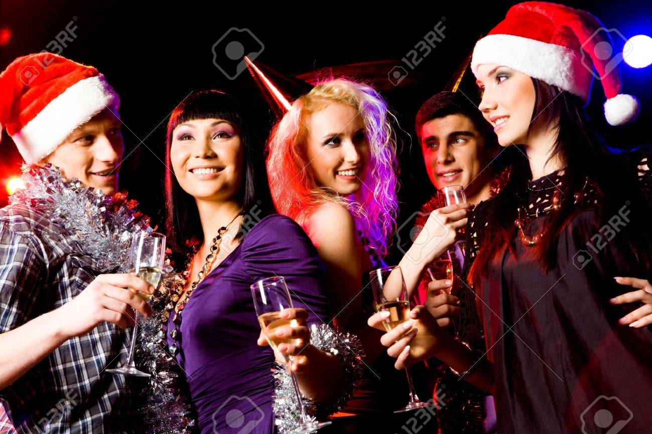 Portrait of modern young people enjoying themselves at New Year party Stock Photo - 6106935