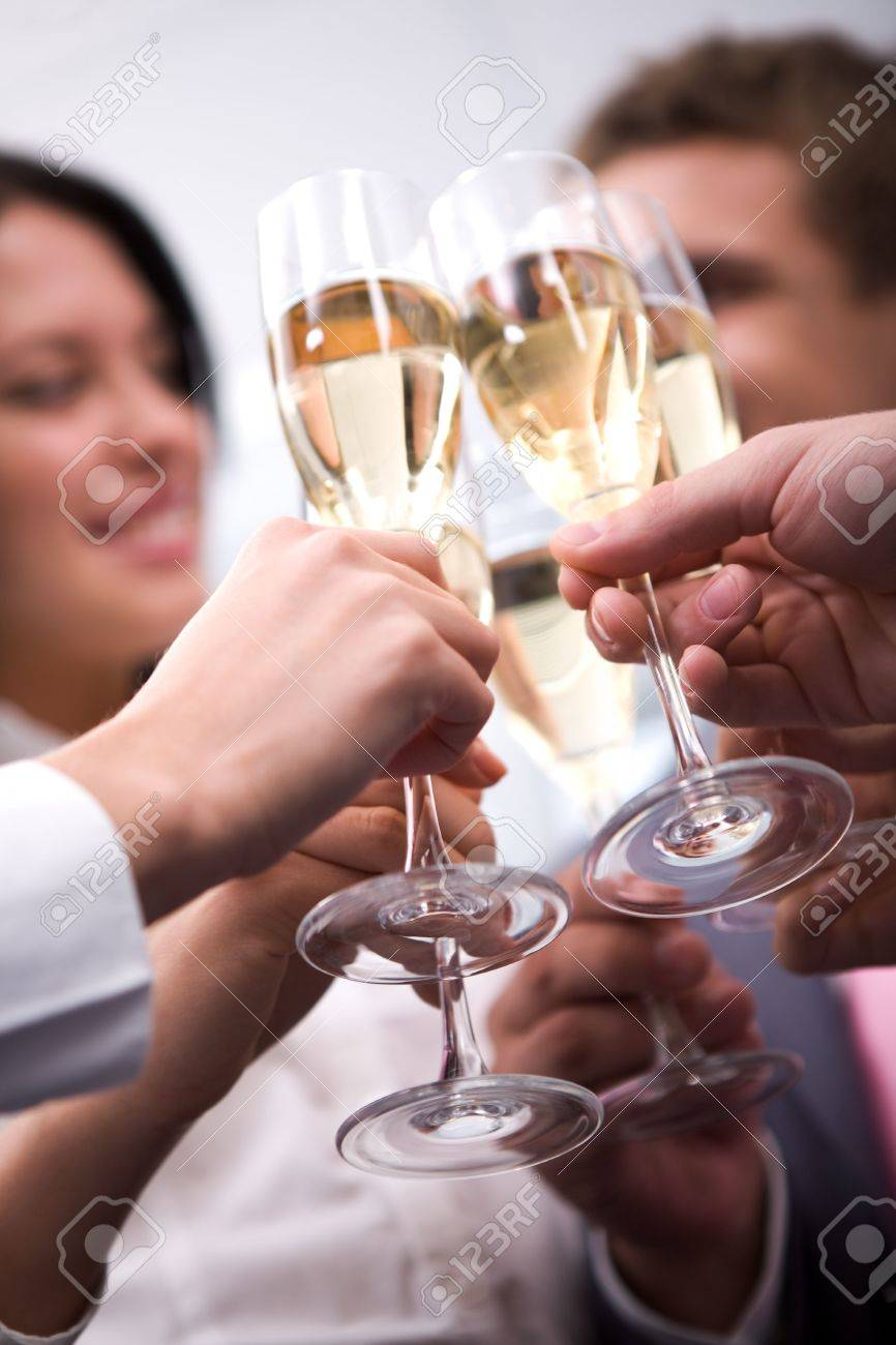 Close-up of human hands cheering up with flutes of golden champagne Stock Photo - 6107276