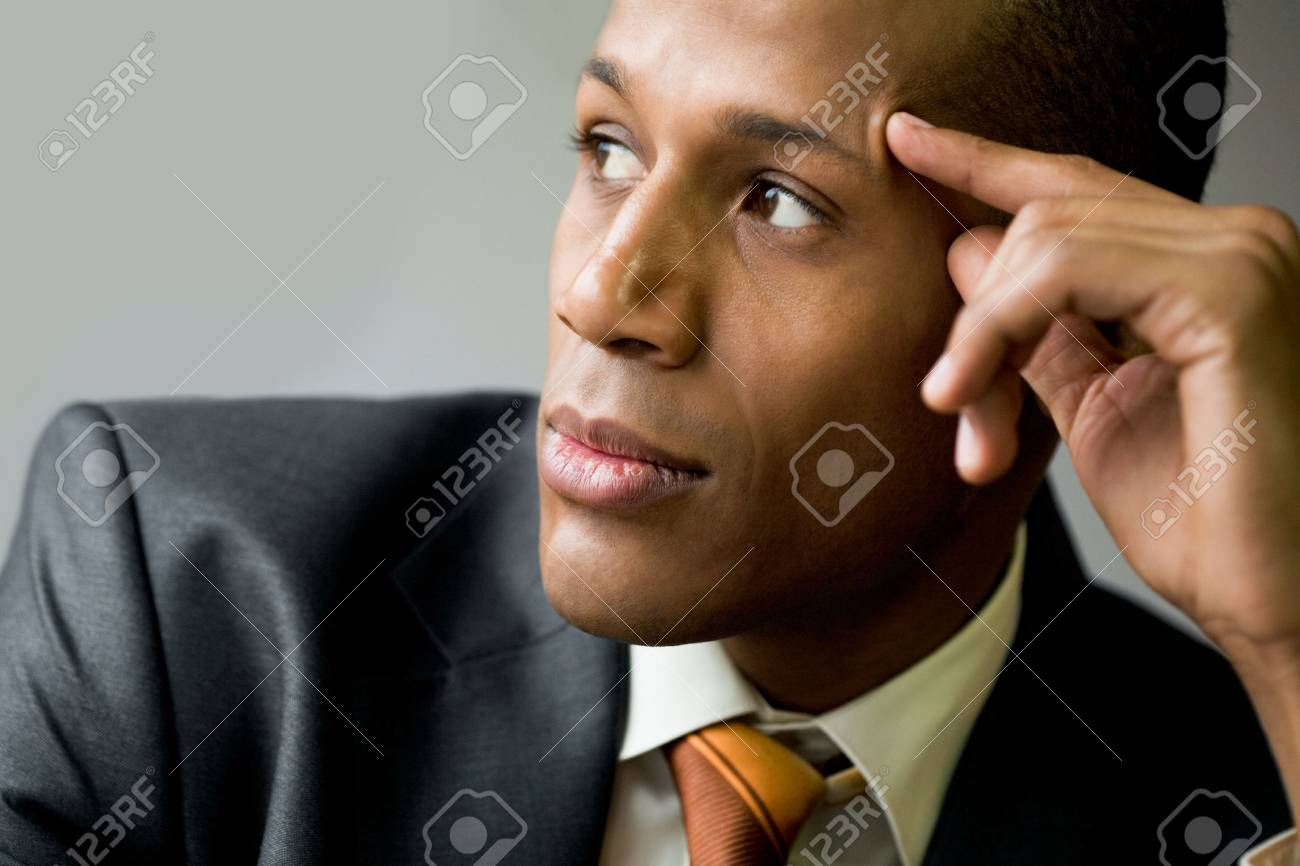 Pensive employee thinking of new ideas and looking aside Stock Photo - 6226692