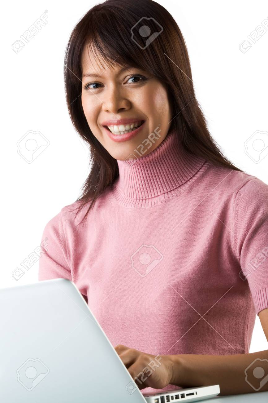 Image of young successful employer typing on laptop and smiling at camera Stock Photo - 6226658