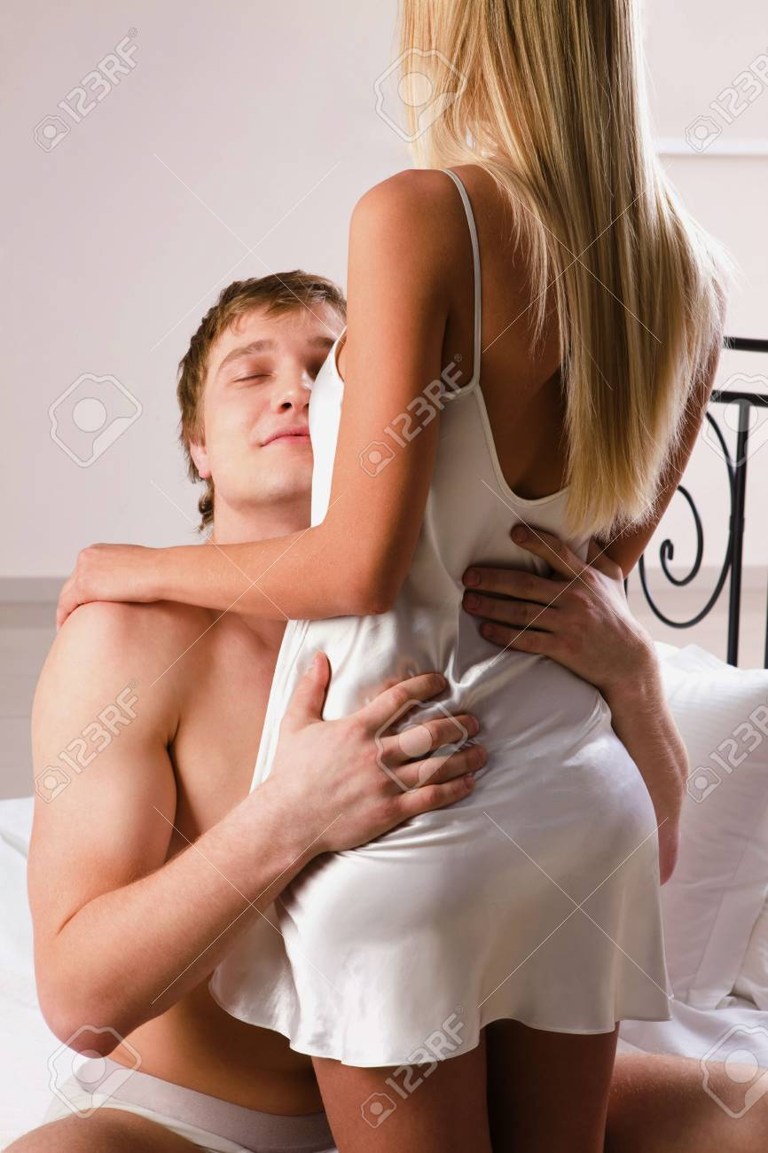 Photo of handsome man embracing his wife with closed eyes Stock Photo - 6614537