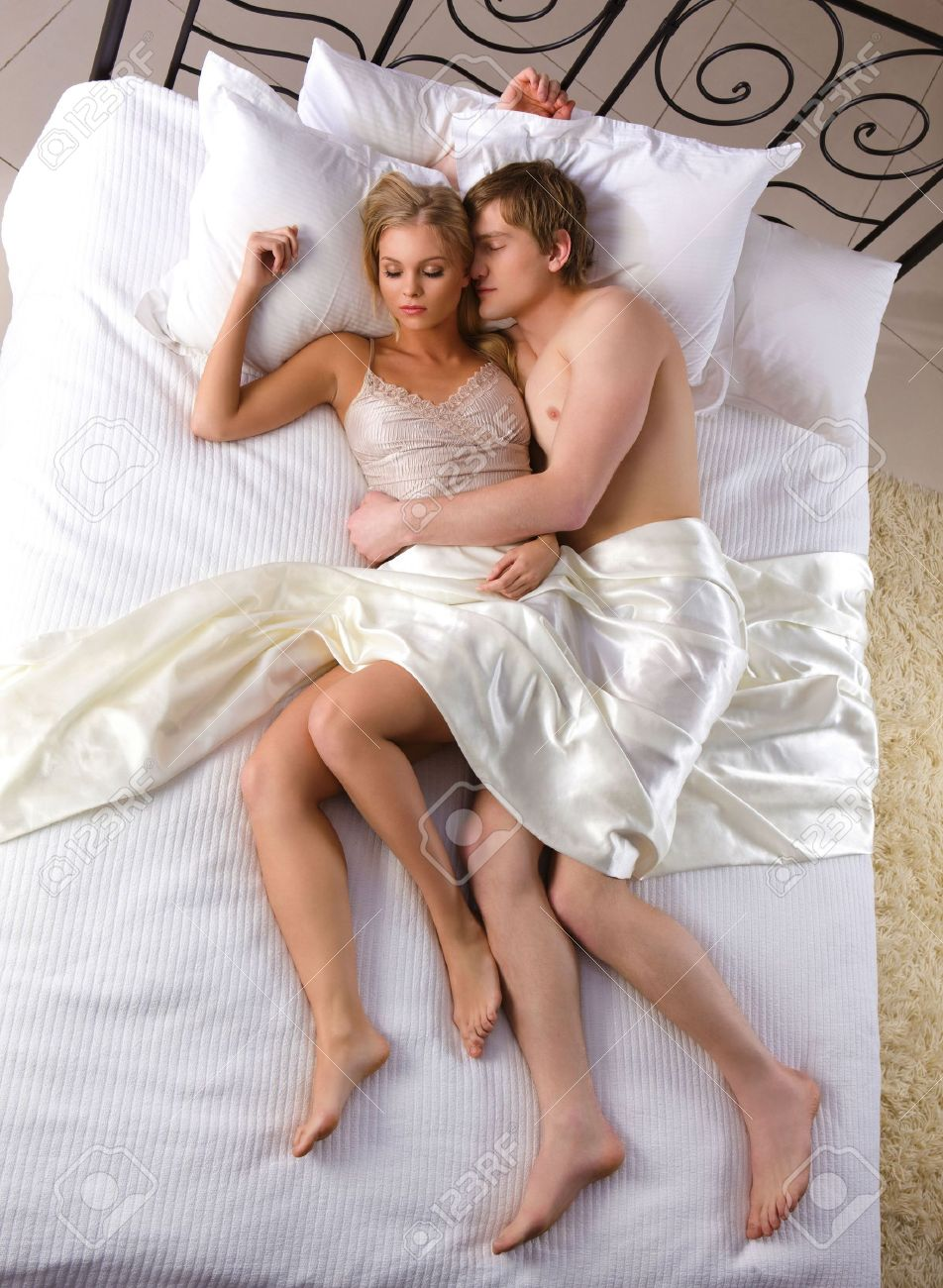 Photo Of Relaxed Husband And Wife Sleeping Together Stock Photo