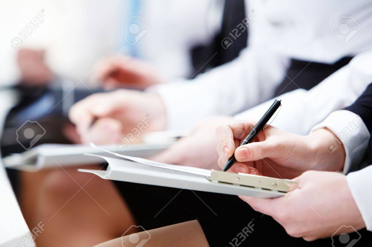 Close-up of business person hands with documents sitting at the lecture - 6669665
