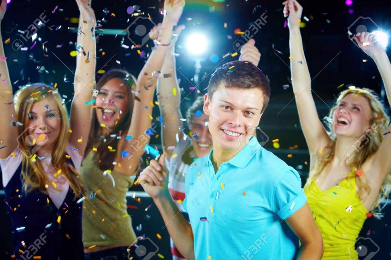 Portrait of stylish guy dancing on background of energetic girls Stock Photo - 6771102