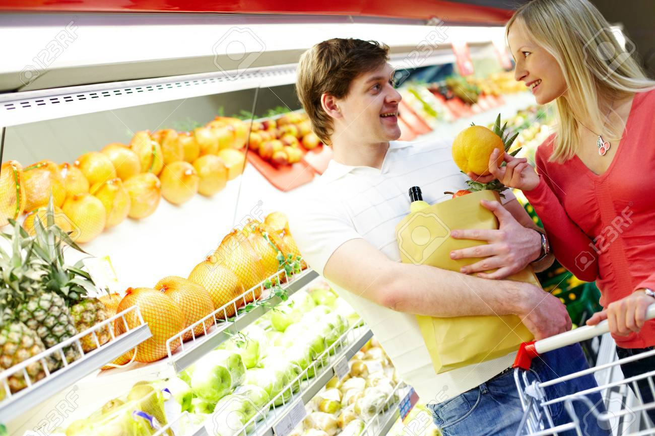 Portrait of happy couple looking at each other in supermarket Stock Photo - 6894254