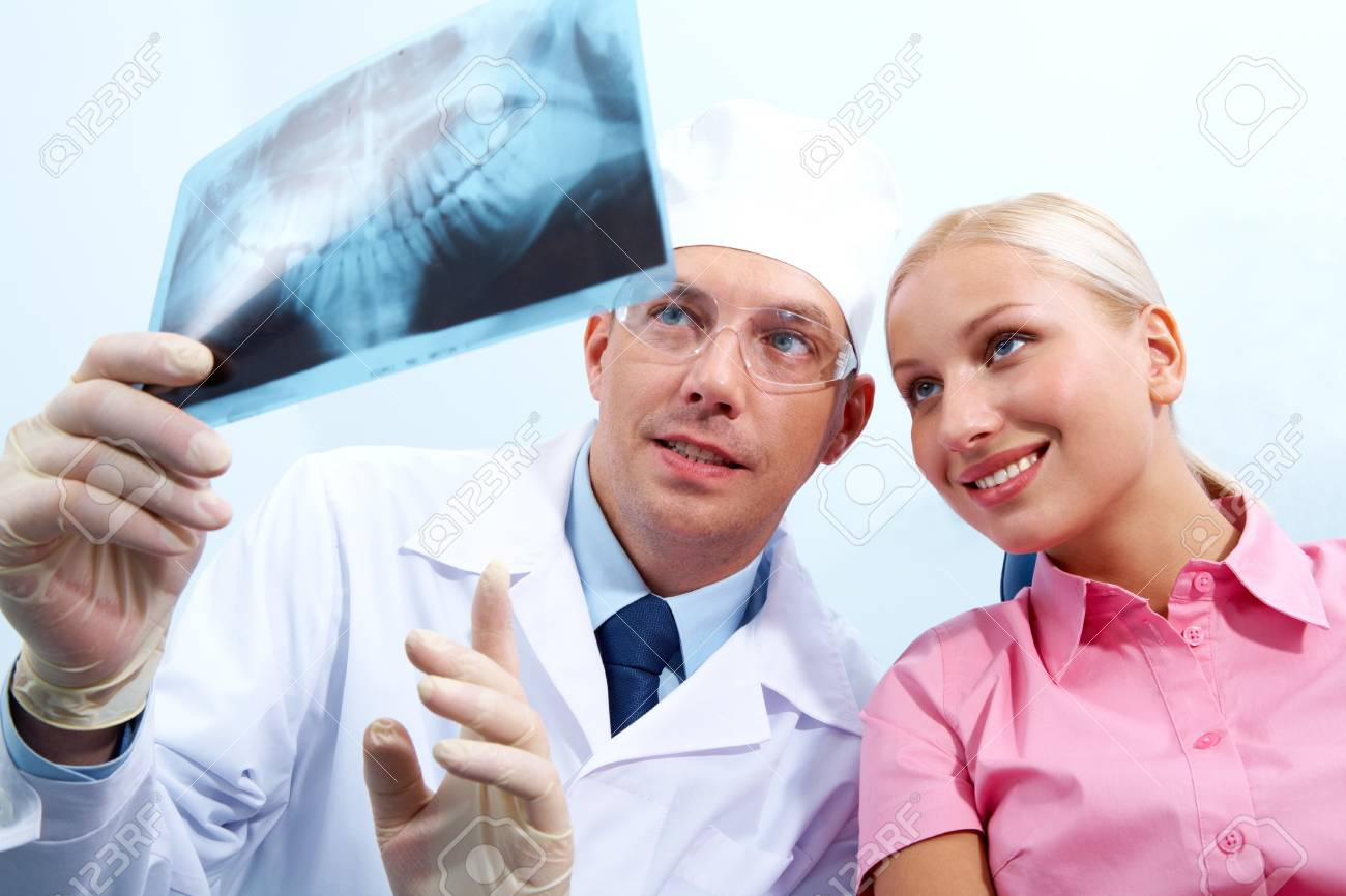 Image of dentist giving medical consulting to woman Stock Photo - 6894813
