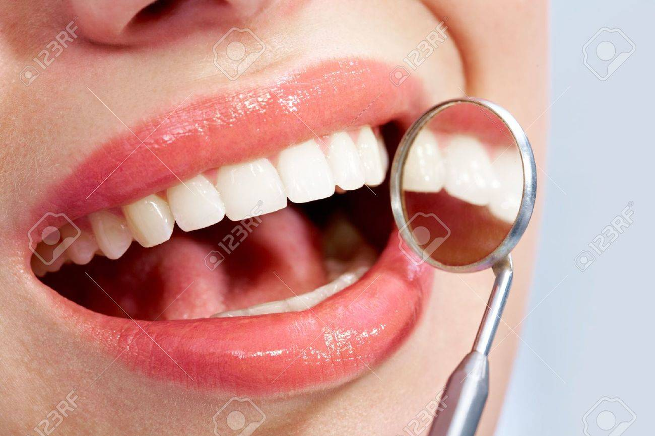 Image of beautiful mouth with health teeth and mirror Stock Photo - 6894806
