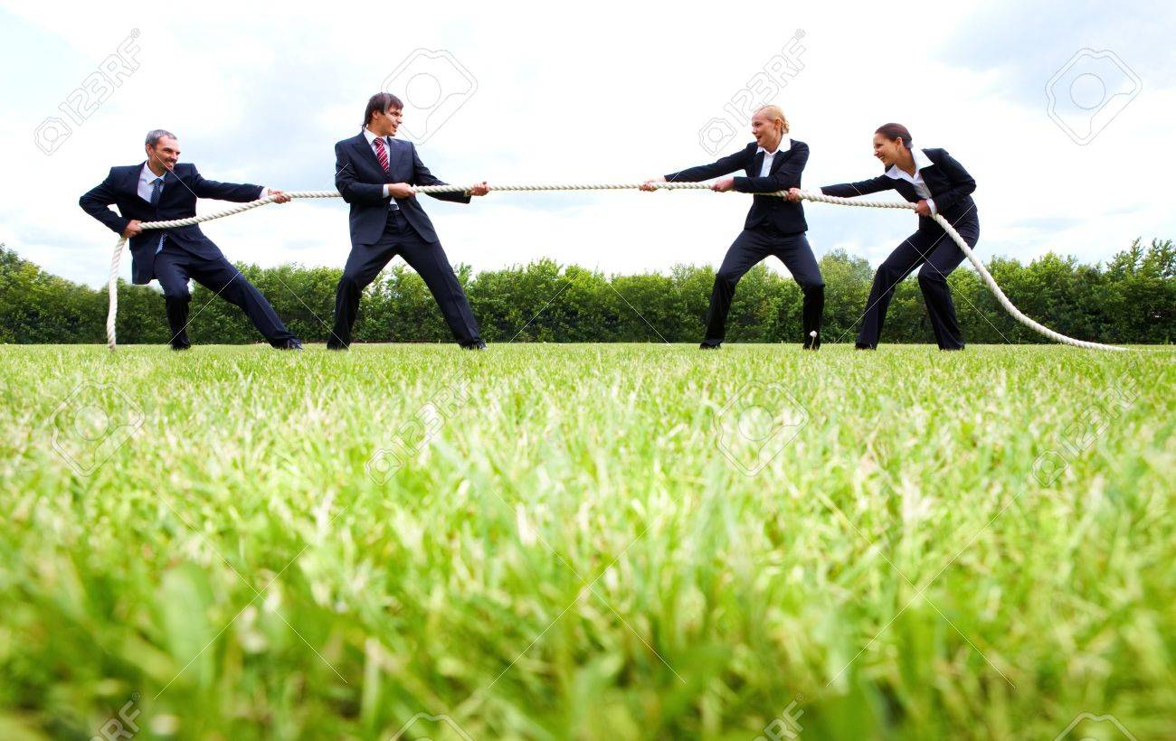 business people stretching the rope in the stadium Stock Photo - 6895033