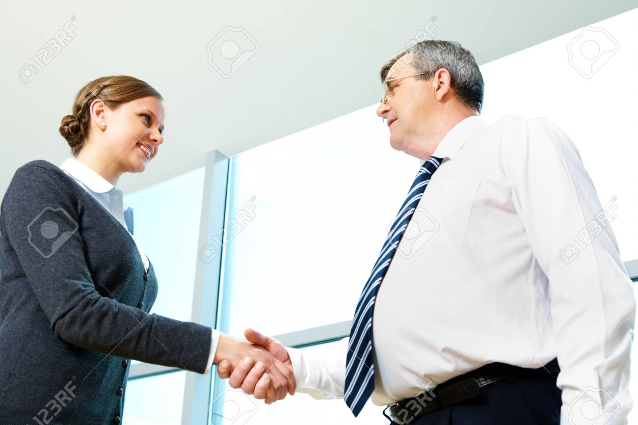 Photo of successful partners handshaking after striking deal Stock Photo - 6962989