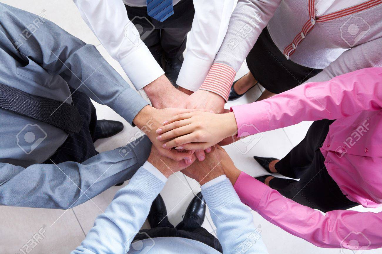 Close-up of business people standing and keeping hands on top of each other Stock Photo - 7032969
