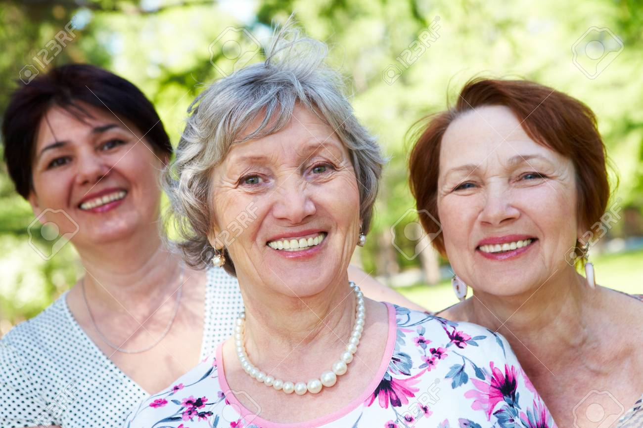 Portrait of three aged women looking at camera with smiles Stock Photo - 7059927
