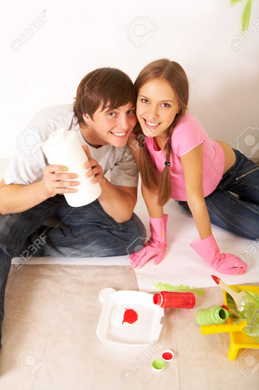 Portrait of happy couple looking at camera while sitting on floor in new flat Stock Photo - 7147865