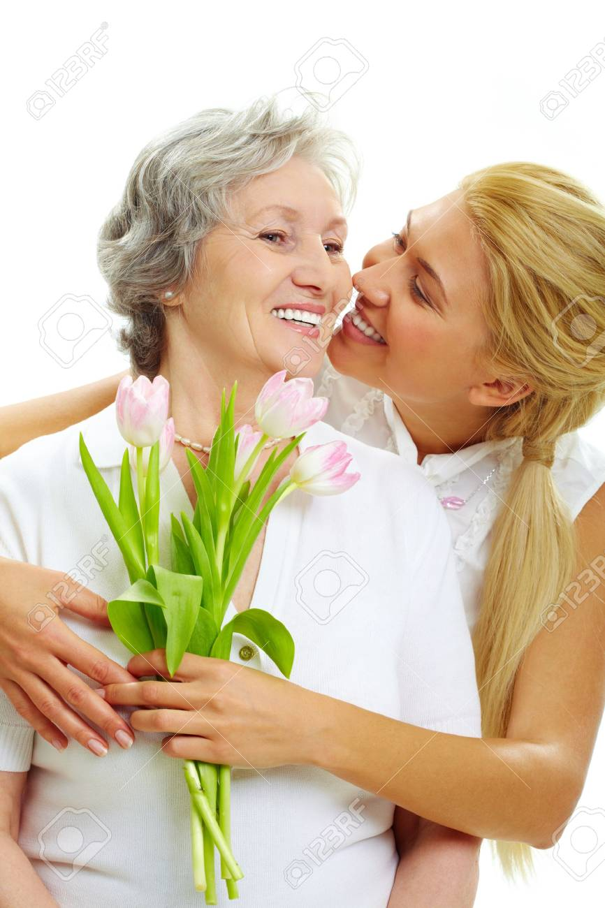 Portrait of pretty woman embracing her senior mother and holding tulips Stock Photo - 7217954