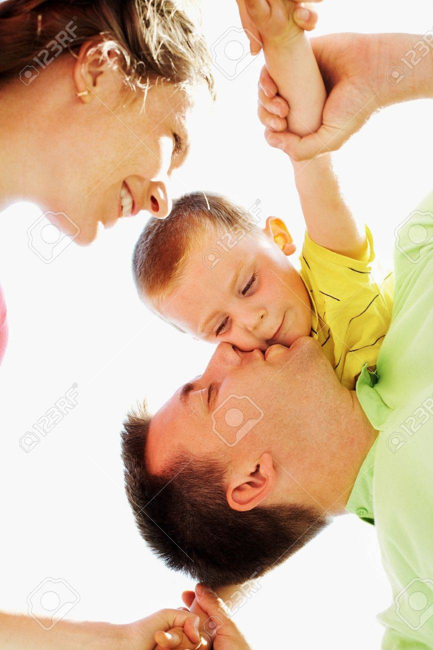 Below view of happy family members having good time on sunny day Stock Photo - 7355664