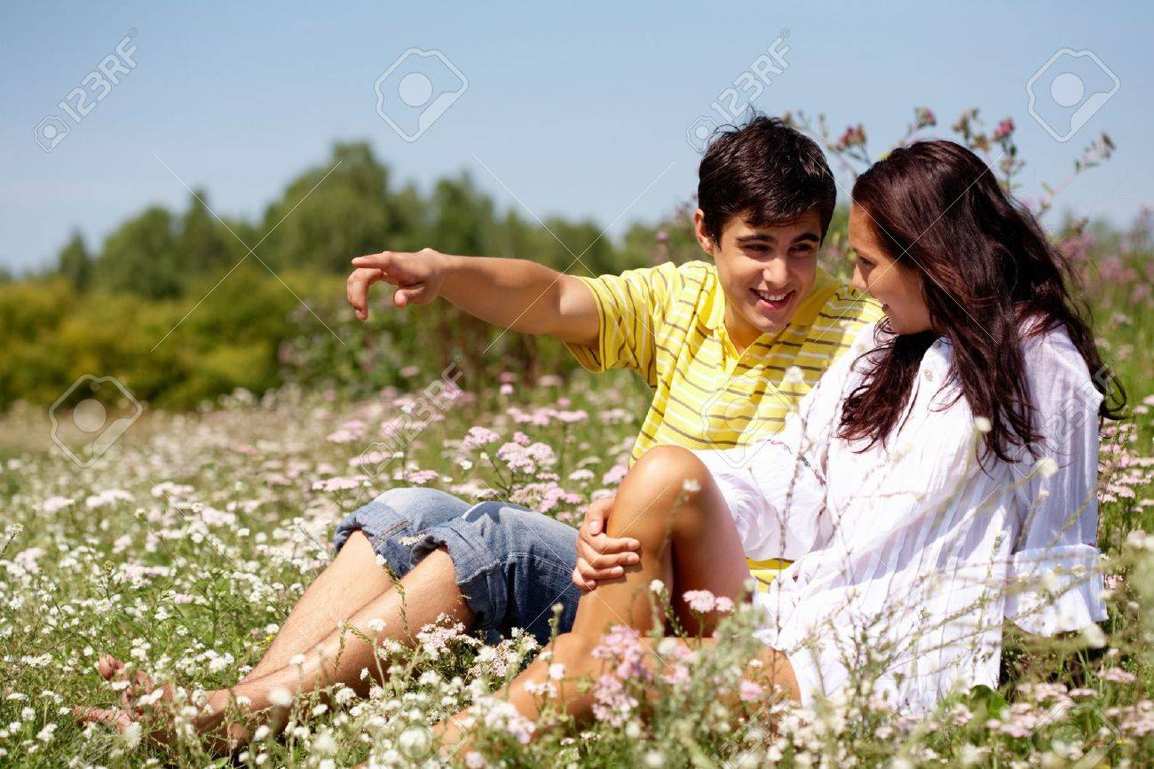 Portrait of young man showing something to woman outdoor Stock Photo - 7458227