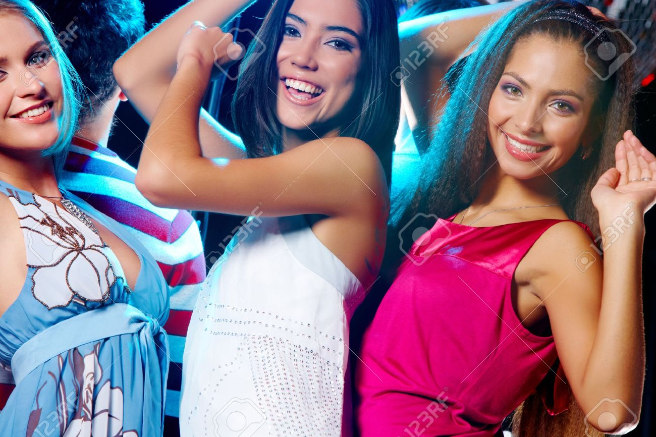 Portrait of three laughing girls dancing at disco in the night club Stock Photo - 7509051