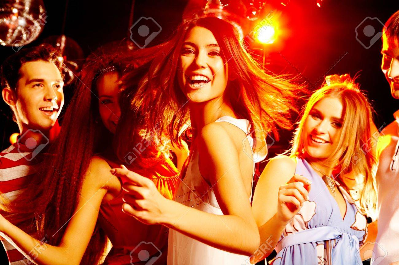 Portrait of laughing girl in white dress dancing among her friends Stock Photo - 7509016