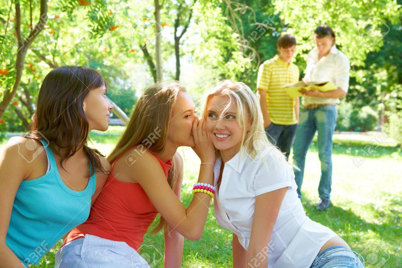 Photo of three girls whispering with each other about guys on background Stock Photo - 7552474