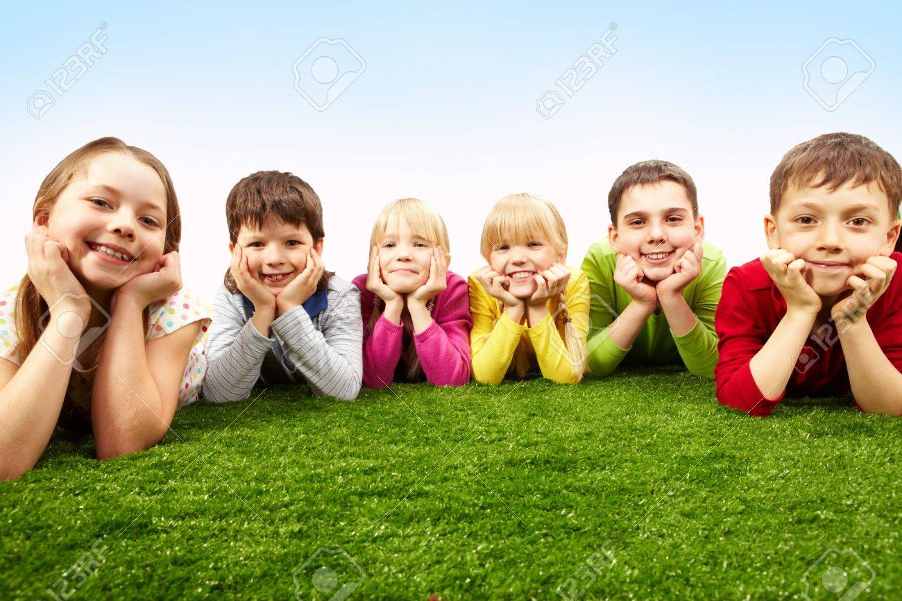 Image of happy boys and girls lying on a green grass Stock Photo - 7602186