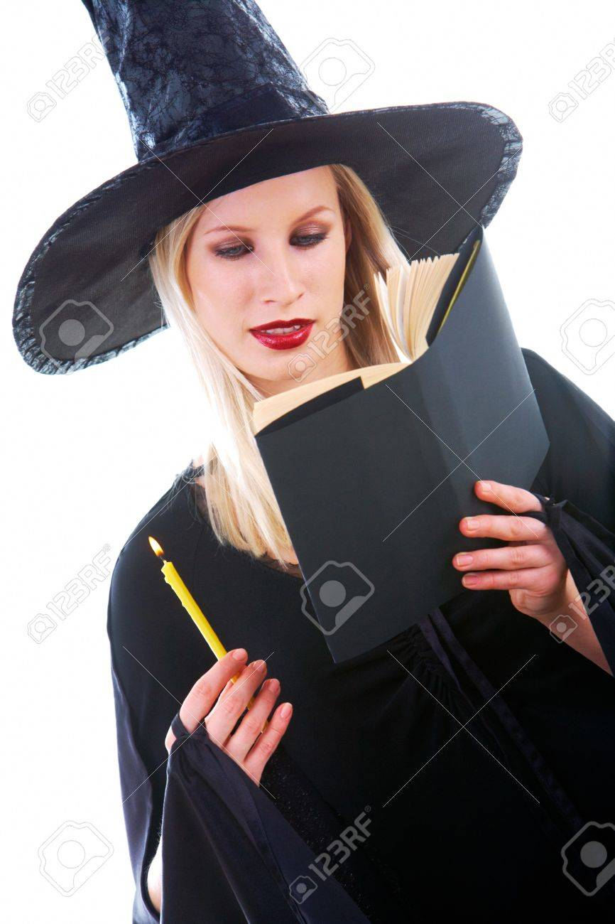 Portrait of young witch reading black book with attention Stock Photo - 7695316