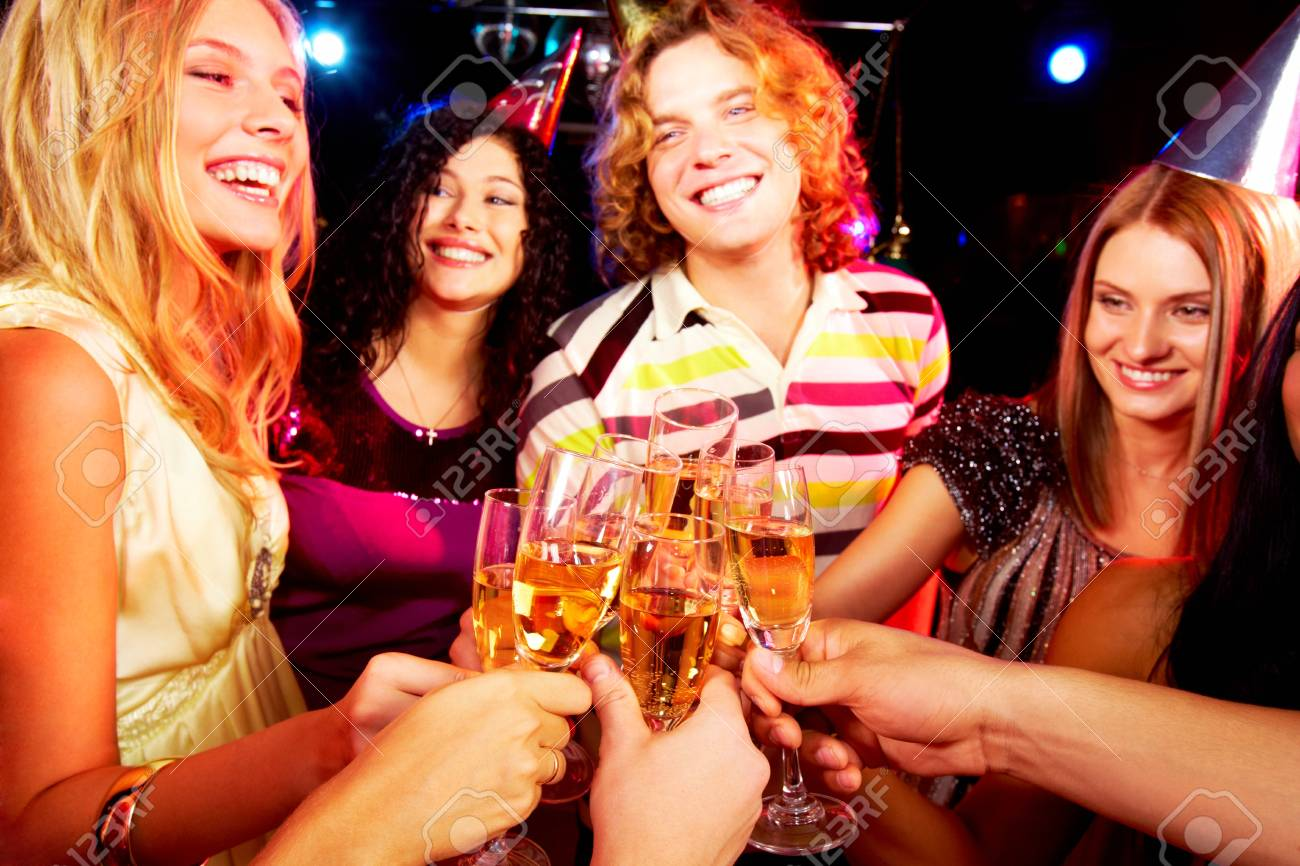 Portrait of group of happy young people toasting at party Stock Photo - 7695872