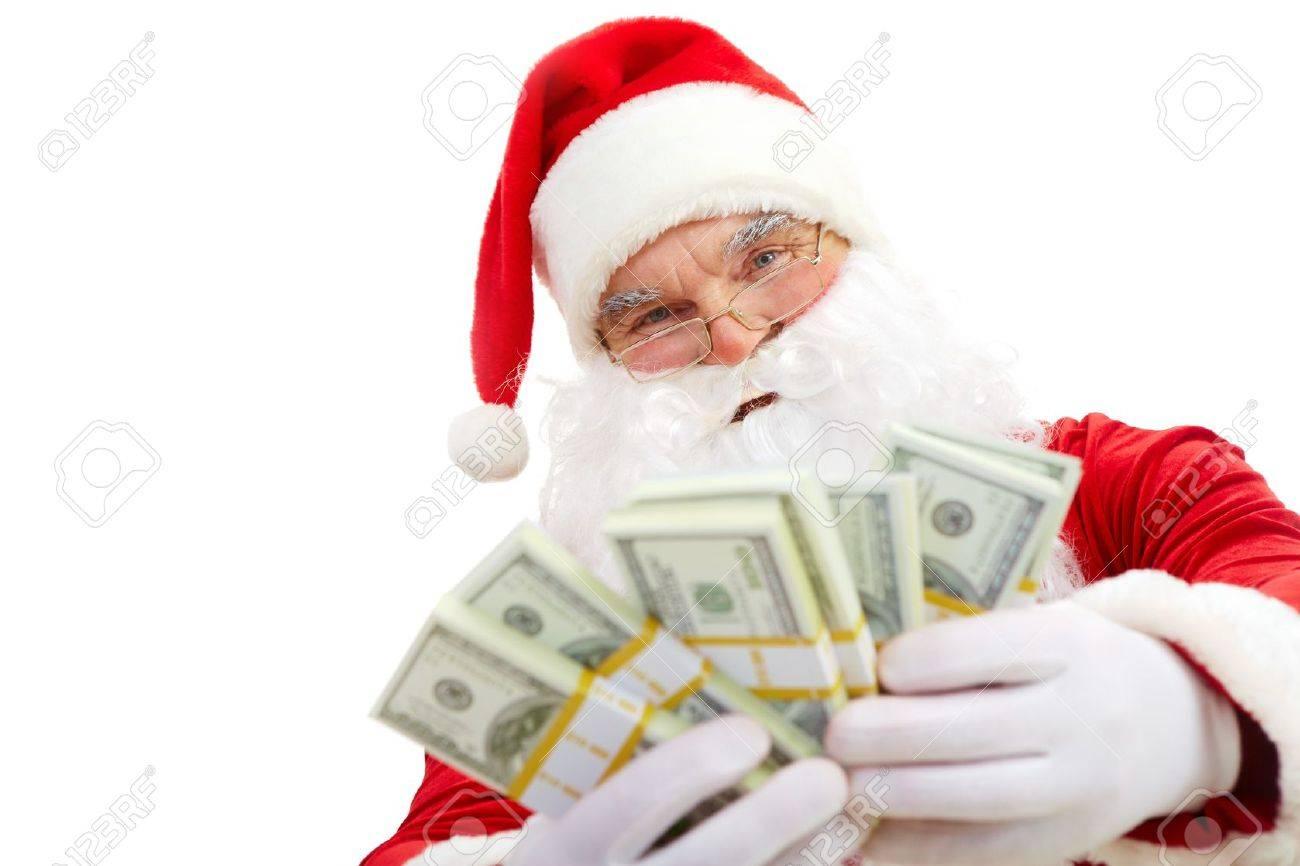 Photo of happy Santa Claus with dollar bills looking at camera Stock Photo - 7803982