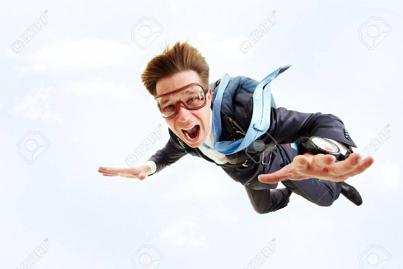 Conceptual image of young businessman flying with parachute on back Stock Photo - 7873826