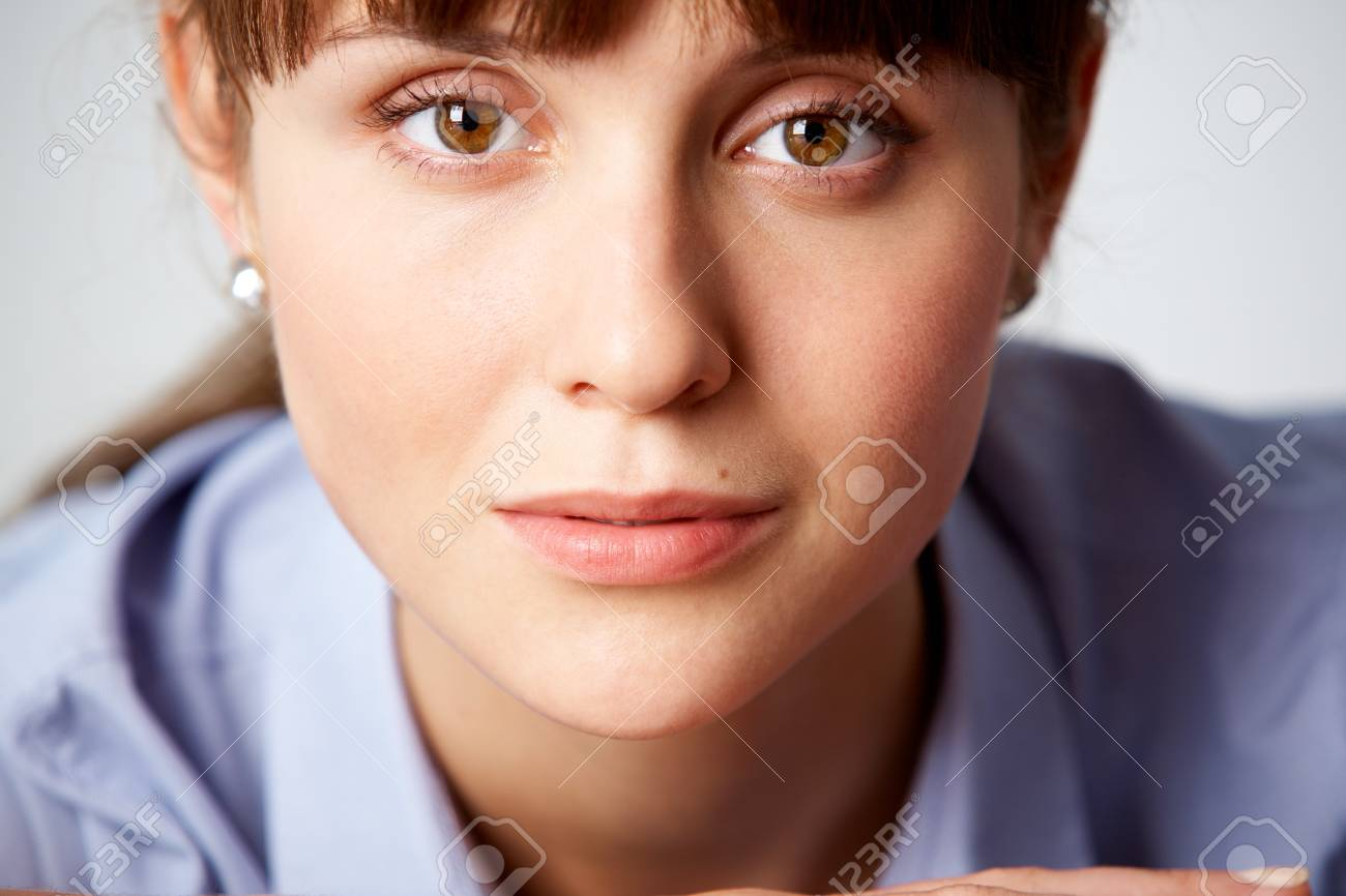 Face of pretty girl with serene expression looking at camera Stock Photo - 7873887