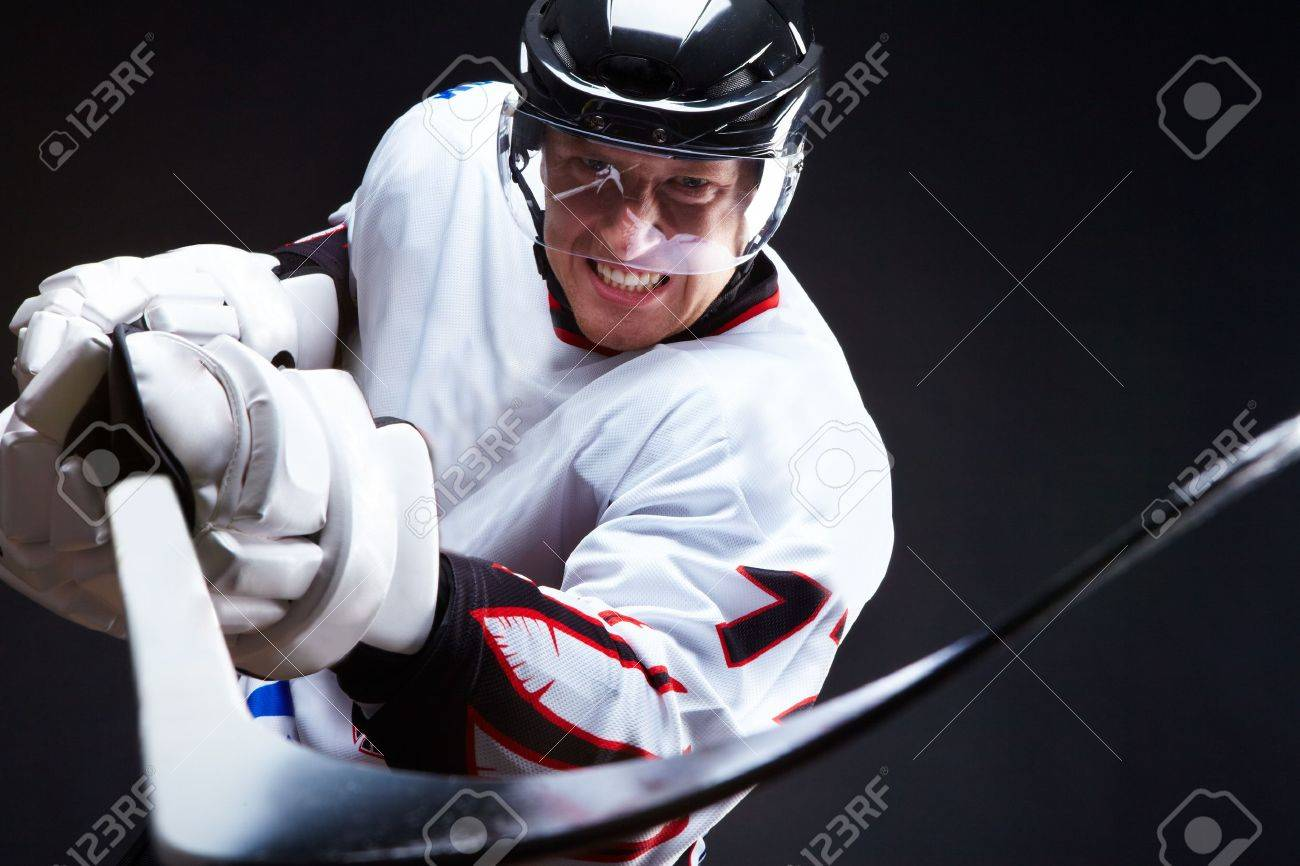 Angry ice-hockey player pointing stick into opponent Stock Photo - 8015781