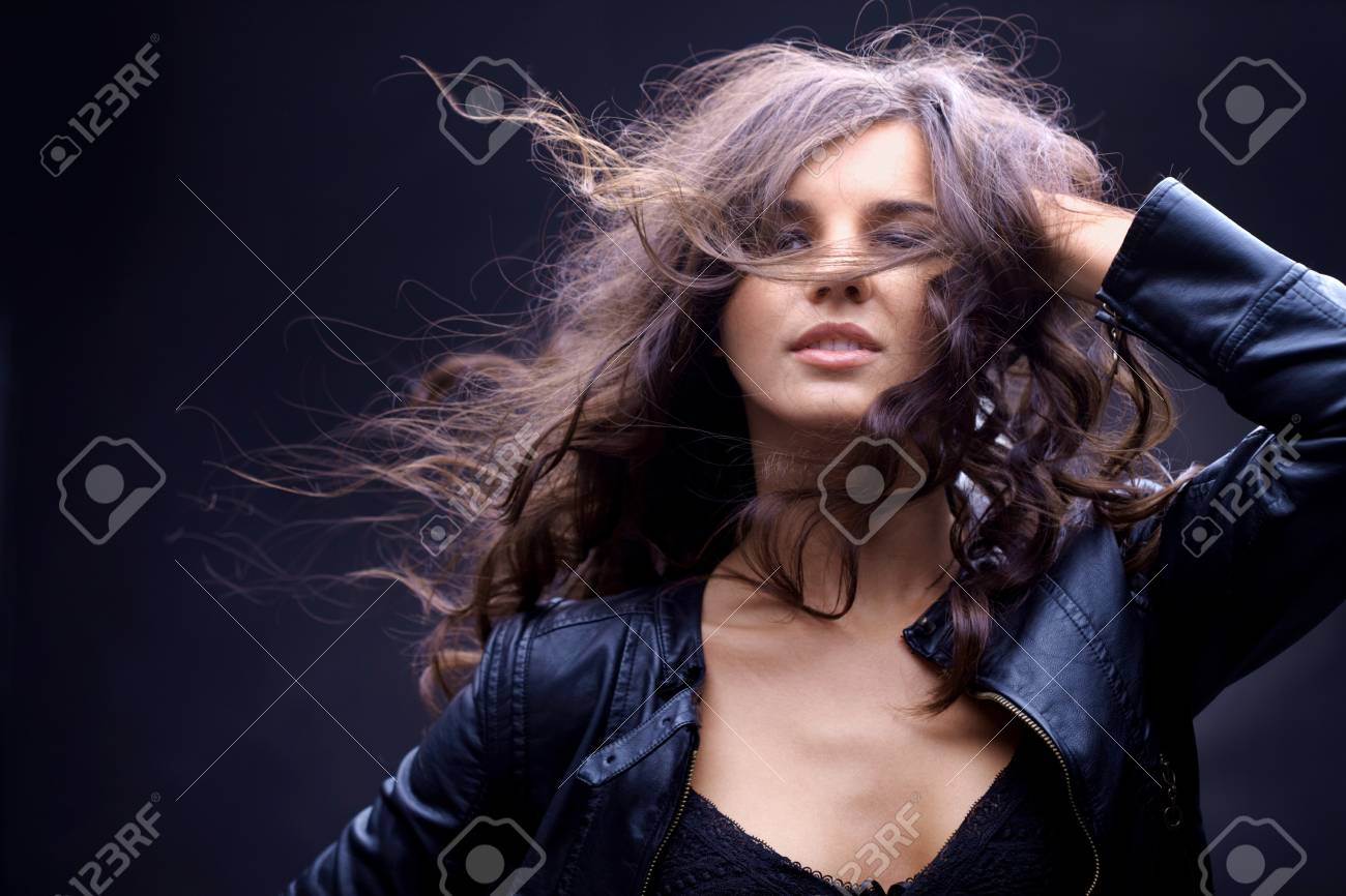 Portrait of a girl with streaming hair against black background Stock Photo - 8015776