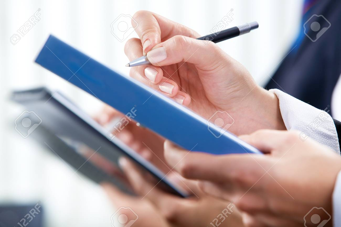Image of human hand writing on paper at seminar or conference Stock Photo - 8062448